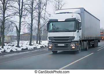 trucks go on the highway in the winter