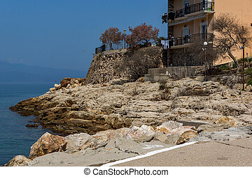 Rocks in the sea on Embankment in Skala Maries, Thassos...
