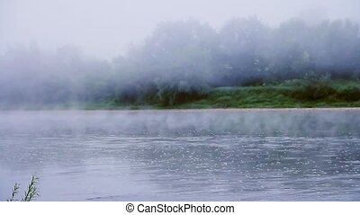 Fog on a river in summer morning