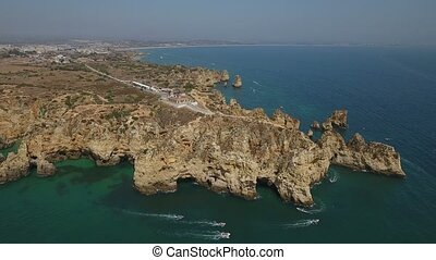 Aerial. Cape Ponta de Piedade, drone filmed from the sky....