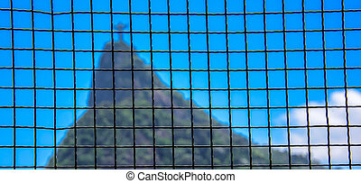 Square grid and blurry Corcovado mountain on the background....
