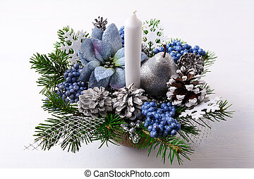 Christmas table centerpiece with candle and blue silk poinsettias