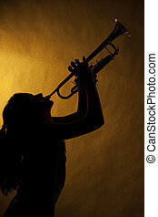 Teenage Girl Trumpet Player In Silhouette
