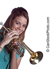 Teenage Girl Holding Trumpet Isolated On White - A smiling...