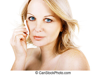 Woman removing make up - A gorgeous middle aged woman...