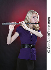 Teenage Flute Player Isolated - A teenage girl female flute...