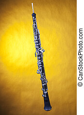 Oboe Isolated On Yellow - A wood oboe isolated against a...