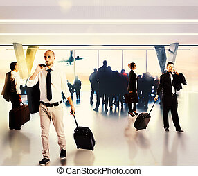 Busy businesspeople in the airport - Busy businesspeople...