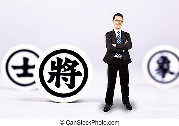 businessman with chinese chess. business Strategy concept