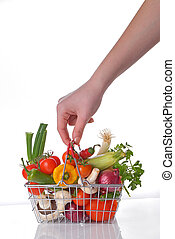 Shopping basket full of fresh vegetables - Hand with wire...