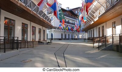 Flags of countries in the Village. Russia, Sochi - Flags of...