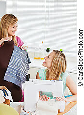 Delighted woman sewing with her friend - Delighted woman...