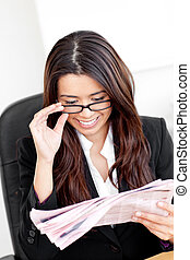 happy asian businesswoman reading the newspaper with glasses...