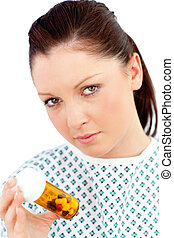 young female patient with pills