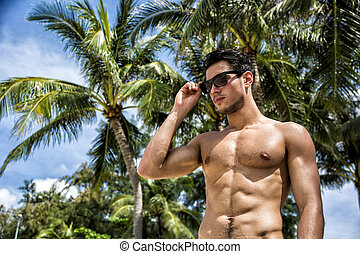Handsome shirtless man looking at camera - Handsome...