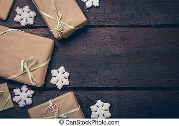 Gifts on the table - Gifts wrapped with the gray paper. Copy...