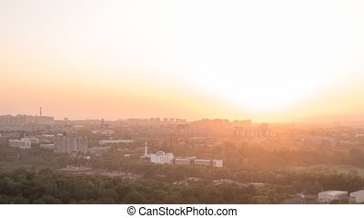 Sunset over the city of Alma Ata. Panorama. Kazakhstan. Time Lapse