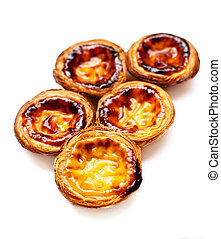 Egg Tarts isolated on white background. Heap of Typical...