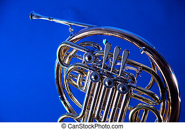 French Horn Isolated On Blue