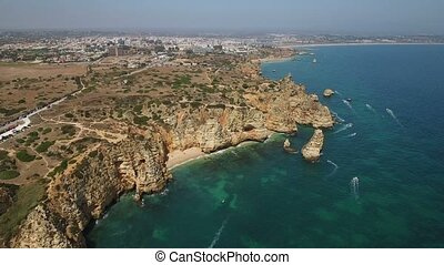 Aerial. Cape Ponta Piedade from the sky overlooking the city...