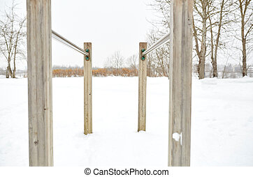 parallel bars outdoors in winter - fitness, sport,...