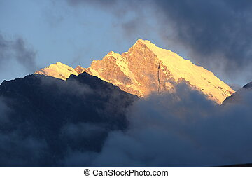 sunrise on snow capped mountain in nepal