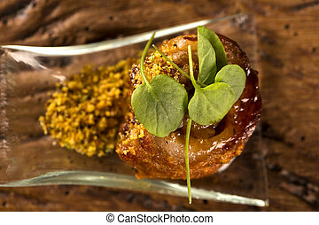Pork ballotine with pururuca, water flour, pumpkin puree and...