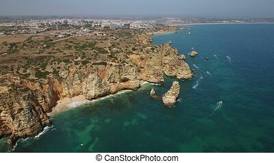 Aerial. Flying over Cape Ponta Piedade, from the sky. Lagos...