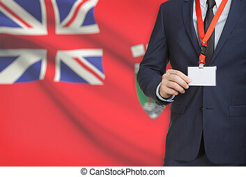 Businessman holding badge on a lanyard with Canadian...