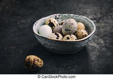 Quail eggs in a bowl.