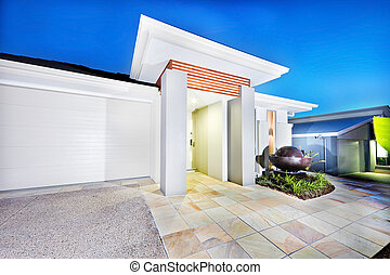 Luxury mansion front side with white walls and garage