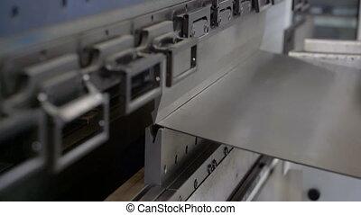 Metal bending machine. worker bends iron