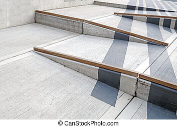 Wheelchair ramp with red carpet for easy access in building.