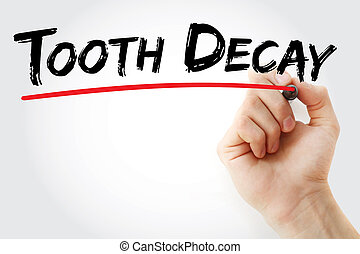 Hand writing Tooth decay with marker