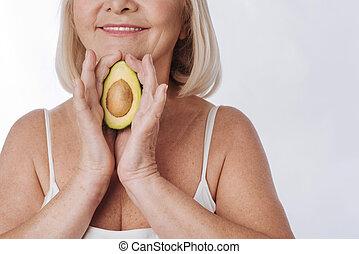 Close up of an avocado half