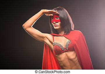 Young super hero woman in studio