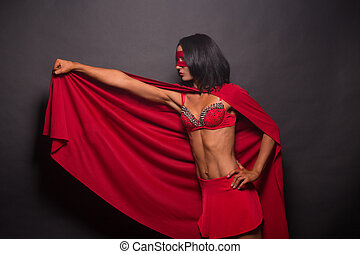 Young super hero woman in studio - Picture of young super...