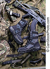 Modern military boots and weapon.Top view - Military...