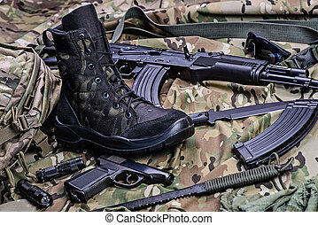 Military boot and weapon.Selective focus - One army boot,...
