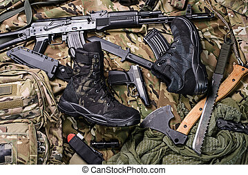 Military clothing-shoes and variety of weapons.Top view -...