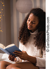 Woman absorbed with a new book - Portrait of a young woman...