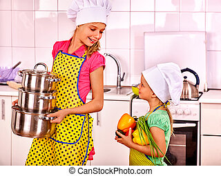 Children washing fruit at kitchen. - Two sisters in caps...