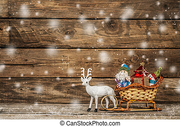 Santa and snowman in a reindeer sleigh with gifts. - Santa...