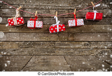 Christmas gifts placed on wooden planks. Copyspace for text