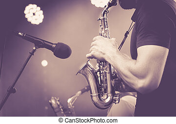 Detail of Saxophone and man hands isolated.