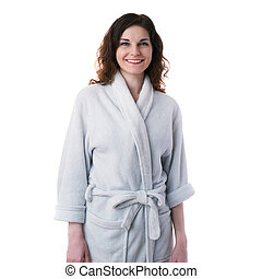 Young woman in bath robe over white isolated background -...