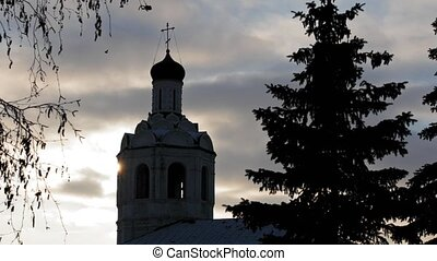 Orthodox church at winter sunset, Russia, telephoto