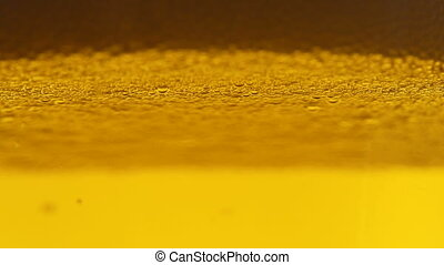 Bubbles floating in beer - Bubbles of air carbon dioxide in...