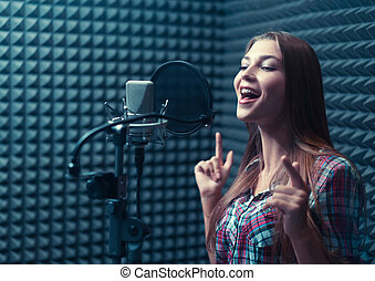 Woman in a recording studio - Singing girl in recording...