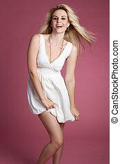 Playful Blond Woman - Beautiful smiling playful blond woman
